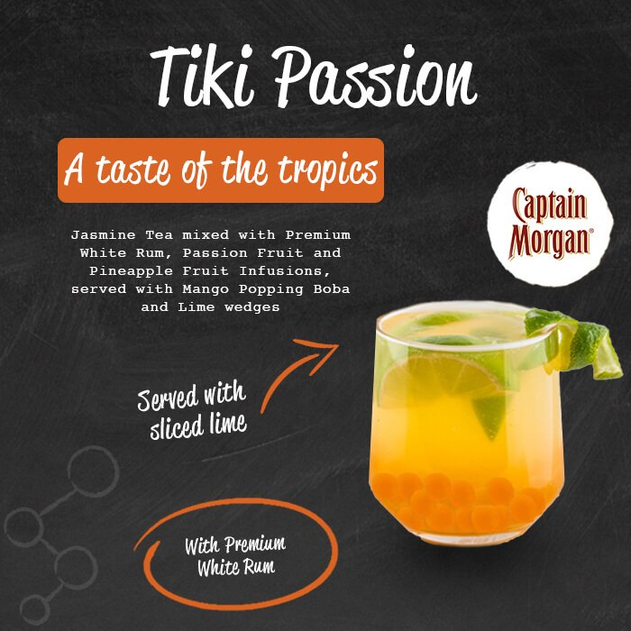 Tiki Passion - a taste of the tropics. Jasmine tea mixed with premium rum, passion fruit, mango and pineapple fruit infusions, served with mango popping boba topped with lime wedges. Served with sliced lime. With Premium rum.