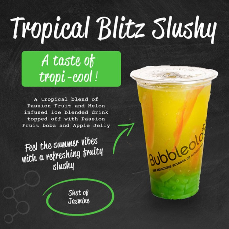 Tropical Blitz Slushy - a taste of tropi-cool! A tropical blend of Passion Fruit and melon infused ice blended drink topped of with Passion Fruit boba and Apple jelly. Feel the summer vibes with a refreshing fruity slushy. Shot of Jasmine.